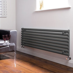 Hudson Reed - Luxury Revive Anthracite Horizontal Designer Radiator 18.5 x 63 - This striking designer radiator, in a fashionable anthracite finish (RAL 7016), boasts an impressive heat output of 1,375 Watts (4,694 BTUs), ensuring that your room is heated quickly and efficiently.With eight Horizontal oval columns bringing a touch of style to any living space, this modern classic connects directly into your domestic central heating system via the radiator valves included (please choose straight or angled). This radiator comes complete with a 5 YEAR GUARANTEE.Luxury Horizontal Single Designer Radiator 18.5 x 63  Dimensions (H x W x D): 18.5 (472mm) x 63 (1600mm) x 2.16 (55mm) Output: 1,375 Watts (4,694 BTUs) Pipe centres with valves: 61.25 (1555mm) Number of columns: 8 Oval columns Fixing Pack Included Designed to be plumbed into your central heating system Suitable for bathroom, cloakroom, kitchen etc. Weight: 46 lbs (21kg) Please note: radiator valves included (please choose straight or angled)  Buy now to transform your living space at an affordable price.5 year warranty Please Note: Our radiators are designed for forced circulation closed loop systems only. They are not compatible with open loop, gravity hot water or steam systems.