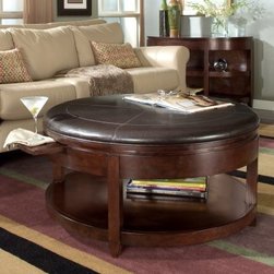 Magnussen T1096-45 Newark Wood Round Coffee Table - Liven up your living room with the convenience of this Magnussen T1096-45 Newark Wood Round Coffee Table doubling as a coffee table and a cocktail table. Constructed from durable hardwood solids and aesthetic cherry veneers this coffee table will easily withstand years of use from the family. It boasts a stylish synthetic leather top that has tone on tone stitching to give a classic yet contemporary appeal in order to match your current decor. The lower shelf provides plenty of storage space for books magazines and media while the roomy top works great for propping your feet up or playing a board game with the family. Don't forget about the two pull-trays that give enough surface area to rest a cocktail glass or hot coffee mug on. Dimensions: Overall: 38 diam. x 19H inches About Magnussen FurnitureFrom its beginning as a small furniture company in Ontario Canada Magnussen Furniture has evolved into a full-line furniture resource with offices in Canada the United States and the Far East. Their business is creating furniture designs of exceptional style value and beauty. They produce these designs in partnership with manufacturing partners around the world that meet exacting standards for superior quality at the best possible value.