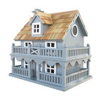 "Home Bazaar Inc. - Novelty Cottage Birdhouse - Blue - Pine shingles top this classic avian residence now available in a stunning BLUE. The fully, functional birdhouse features a removable back wall for easy cleaning with a 1 1/4"" side entry hole to a single, unpainted nest box plus ventilation and drainage holes. A convenient, swing-up paddle-board attached to the back allows you to hang this beautiful birdhouse anywhere. Constructed of kiln-dried hardwood."