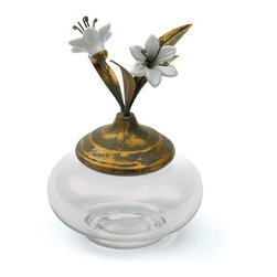 "Go Home - Go Home Flowering Accessory Jar - Enhance your decor with praiseworthy Country chic Accessory jar. This jar is referred as praiseworthy not only because of its elegant look but due to its functionality as well. Its top cover is projected with floral designs, makes it look exquisite. It can be place in any part of your living area. It is simply exuberating centerpiece with beautiful blooming flowers. These jars can also be used to keep your daily accessories making your area clutter free. Its beauty and charm gives a great impact on the ambience of whole area. This beautiful and functional accessory jar shows perfect blend of craftsman""s skill and innovation."