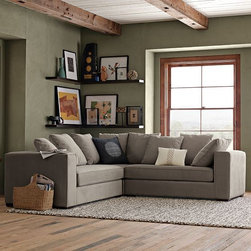 Walton Sectional - Casual comfort that cries out for someone to curl up on it. The five loose back cushions, wide arms and perfect seat height make this sofa a prime spot for lounging, one that can be arranged in a number of conversation-conducive configurations.