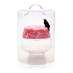 Esque - Ghost Cake Plate/Lid - Birthday cake takes on an otherworldly look with this enticing piece. Cloaked in glass, the illusion of a perfectly pink treat floats inside, watched over by a little bird straight out of Poe. It's a work of art that inspires both the brain and the stomach.