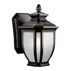 Kichler 1-Light Outdoor Fixture - Rubbed Bronze Exterior - One Light Outdoor Fixture With an unmistakable British influence this elegant 1 light energy efficient wall lantern displays enduringly good-taste for exterior applications. Rubbed bronze finish and white-linen glass style and refinement for your home. , 1-light, 2700k pls 13-w. Lamps included. . Width 6, height 10-1/2, extension 7. Height from center of wall opening 2-1/4. Backplate size: 5 x 7-1/4. U. L. Listed for wet location.