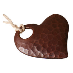 "Native Trails - Copper Heart Ornament 2"" - Give them a little piece of your heart. This rustically charming ornament is handmade by artisan for one-of-kind character. And, it arrives ready for gift giving in a pretty organza bag."