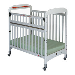 "Foundations - Compact Safereach Crib with Adjustable Mattress Board-Clearview White - There are reasons why Serenity cribs are the most widely used cribs in U.S. child care facilities. Serenity offers an unprecedented amount of features to select from. Mortise and tenon construction headboard provides added strength. Mattress board adjust to two heights Nonmarking, ultra quiet commercial casters (two locking). Lower profile allows easier accessibility to infant. SafeSupport solid steel frame provides unprecedented strength. Includes Professional Series ultra durable, antimicrobial 3"" mattress. Color coordinated finishes are matched with hardware and casters for added beauty. Five-year warranty on crib with lifetime warranty on steel frame, casters, and hardware. Mattress board adjusts to two heights."