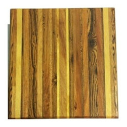 "Exotic Chopping Blocks - 12"" x 12"" Cutting Board - The vibrancy of this board brings life to any room! The bright woods give off a feeling of joy and the aesthetic quality of the sequence of the woods creates a sense of graceful excitement. Woods used in this board are Yellow Heart and Canary from South America and Bocate form Mexico. All the woods are their natural colors. There has been no paint or stain added."