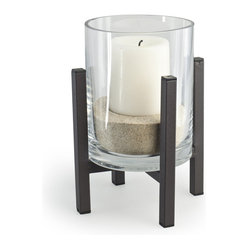 Danya B. - Cylinder Hurricane on Metal Stand - Create a peaceful ambience by lighting a flame, encased in modern glass and rustic iron. Your candle will be protected by the hurricane cylinder of recycled glass, so go ahead, turn on the fan!