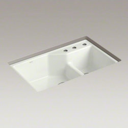 """KOHLER - KOHLER Indio(R) 33"""" x 21-1/8"""" x 9-3/4"""" under-mount Smart Divide(R) large/small d - Add a modern vibe to the kitchen with the crisp design of the Indio sink. The large/medium bowls allow you to keep clean and dirty dishes separate while offering plenty of room for oversize pots and pans. Crafted from enameled cast iron, this sink resists"""