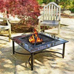 "Marble Fire Table - Create a gathering spot for your family and friends in your backyard with a quality marble topped fire table. This furniture style fire pit features a 23"" steel fire bowl surrounded by a 34"" black marble tile surround. Enhance your outdoor experience with the beauty and warmth of a fire table."