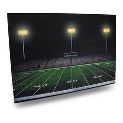 Zeckos - Forever Friday Night Football Field Canvas Print 20 x 14 In. LED Lights - This awesome wall hanging features an image of a small town football field, with the lights beyond the bleacher seats blazing. LED Lights placed behind the banks of lights bring this wonderful print to life. It measures 20 inches long, 14 inches high and 1/2 an inch deep with an attached hanger tab that makes mounting on any wall simple. The lights are powered by 2 AA batteries (not included) accessible on the back side, are controlled by an inconspicuous on/off switch on the side, and unsightly wires are concealed and contained by the vinyl backing. The image is printed on canvas stretched over a wood frame, and is a lovely accent in bedrooms, living rooms, and man caves