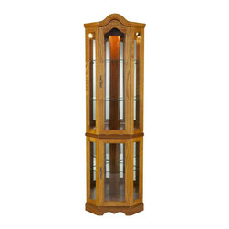 Holly & Martin - Holly & Martin Riley Lighted Corner Curio Bab - Golden oak finish. Mirror backed with light. Tempered glass front. Assembly required. 21.25 in. x 15.5 in. x 70 in. H . Assembly instructionsDisplay your collectibles with pride in this lighted curio cabinet. Mirrors are present on both back edges to enhance the lighting of your items and give more visual depth. The golden oak finish compliments the simple straightforward design with H vertical panes and decorative arch top. Two adjustable shelves are present in the upper cabinet that can be raised, lowered, or removed to suite your needs. Additionally, the lower cabinet also contains one adjustable shelf. This lighted corner curio is sure to become a cherished piece of furniture in your home.