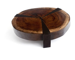Bolacha Star Coffee Table - The natural rustic moods in the Bolacha Star Coffee Table create casual sophistication and timeless elegance. The age of the wood heightens the interest of the piece with visible rings in the tree cross-section tabletop. Three dark-stained wood legs split the table top into three sections of rich wood, adding angular depth and a modern touch to the rugged piece. Made from a beautiful reclaimed raw edge wood slab, the coffee table is a heirloom-quality piece that is perfect to center your living space around.