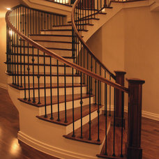 Traditional Staircase by Meschi Construction Inc.