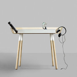 """My Writing Desk / small - This is a writing desk designed to reduce the difficulties of working in a mess. It has its storage space organised around the table top where all the things are always in sight and easily accessible. The desktop can be used right up to the edges without worrying that things might fall down, and any unnecessary objects can simply be pushed to the storage sides. The high edges of the desk isolates it in the room and creates a positive microclimate where things """"feel good"""" in relationship with the user.The wings are divided for simple construction leaving a path for the wires. There are two drawers for a laptop and writing equipment. The legs of the table can be twisted off for easier transportation."""