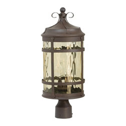 Exteriors - Exteriors Espana Traditional Outdoor Post Lantern Light X-19-5105Z - Rustic details compliment the cylindrical shape and subtle Spanish influencing of this Craftmade outdoor post lantern light. From the Espana Collection, the rivet detailing has been paired with elegant curled accents and rustic banded metal accents. This post light also features a fluid hammered champagne glass shade paired with an eye-catching Rustic Iron finish that accentuates the rustic charm of the design.