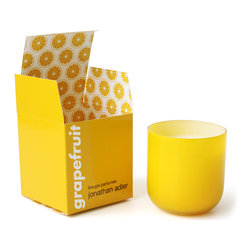 Grapefruit Pop Candle - It's nice to add a pretty scent to your workspace, and why not do it in style? I love the citrus color and smell of this beauty by Jonathan Adler.