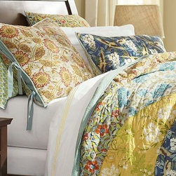 Scalloped Organic Cotton Patchwork Quilt, Twin - Our Scalloped Organic Patchwork Quilt captures the spirit of art nouveau, with its flowing, curvilinear forms and stylized botanicals.All-cotton quilt is hand made.Organic cotton cambric quilted over all-cotton batting.Overlapping fan-shaped patches are edged with porcelain-blue piping.Quilt reverses to solid blue.Shams feature a different print on each side and side ties for easy reversibility.Inserts sold separately.Machine washable.Watch a video on {{link path='/stylehouse/videos/videos/pbq_v10_rel.html?cm_sp=Video_PIP-_-PBQUALITY-_-QUILTS_AMERICAN_ART' class='popup' width='950' height='300'}}quilting as an American art form{{/link}}.Catalog / Internet Only.Imported.