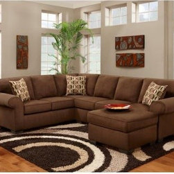 Chelsea Home Adams 2 Piece Sectional with Full Sleeper - Patriot Chocolate - Relax and entertain like royalty with this Chelsea Home Adams 2 Piece Sectional with Full Sleeper - Patriot Chocolate. The large six-cushion sectional features several luxuries including smooth microfiber upholstery soft and supportive seats and a hidden crown jewel in the form of a chaise that extends wide and long to provide room enough to sleep. At a total of just under 10 feet wide the sofa comfortably seats six or seven for family gatherings sporting events and cocktail parties – plus up to three for overnight stays. It was constructed with a kiln-dried hardwood frame that provides support while in use and during potential relocations across town and country. The cushions are made of high-density foam and an innovative sinuous spring system that maximizes comfort while providing support meaning your family and guests will feel just as good relaxing in the afternoon as they do sleeping at night. Individually the loveseat measures 82 inches while the sofa measures 96. About Chelsea Home FurnitureProviding home elegance in upholstery products such as recliners stationary upholstery leather and accent furniture including chairs chaises and benches is the most important part of Chelsea Home Furniture's operations. Bringing high quality classic and traditional designs that remain fresh for generations to customers' homes is no burden but a love for hospitality and home beauty. The majority of Chelsea Home Furniture's products are made in the USA while all are sought after throughout the industry and will remain a staple in home furnishings.