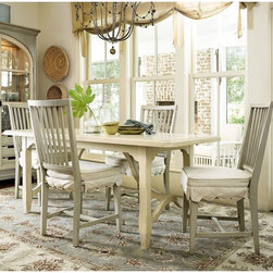 Paula Deen Home - Paula Deen River House Kitchen 5 Piece Dining Table Set - River Boat/Oyster Shel - Shop for Dining Sets from Hayneedle.com! The lightly textured Paula Deen River House 5 Piece Dining Table Set River Boat/Oyster Shell is a collection of delicately aged pieces with the depth and character to truly elevate your surroundings. The table features solid construction of cherry veneers and select hardwood with tapered legs decorative supports a molded edge design and bright finish of white River Boat with hints of gray rub-through. The subtly antiqued table is surrounded by four Oyster Shell chairs that share the same quality craftsmanship and show off such fine details as a slatback tapered legs of their own and a saddle seat with removable seat cushion for added comfort. You can complete the collection and add an impressive amount of storage options to your setting as well by choosing the optional Best Dishes Pantry in Oyster Shell to coordinate with the seating arrangement.Additional InformationChina cabinet with two glass doors and interior lightingOyster Shell finish with light accentsAdjustable wood-framed glass shelvesSix tray drawers with carved cut-out handlesChina cabinet dimensions: 55W x 20D x 83H in.About Paula Deen HomeBring comfort home with the only collection of furniture inspired by the way Paula Deen relaxes in her own Savannah abode. These pieces all showcase an inviting country style that captures the beauty history and hospitality of life in rural Georgia. Not only do these furnishings offer a graceful elegance but they are assembled to the highest quality to really stand the test of time with features such as solid hardwood frames dovetail joints drawers that glide easily and a clean consistent finish that withstands the wear and tear of daily use. Paula Deen Home partners with Universal a company recognized as a leader in exceptionally crafted furniture and bedroom dining room and occasional products as well as entertainment centers 