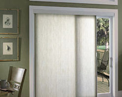 """Comfortex Ovations 3/4"""" Single Cell Light Filtering - Comfortex Cellular Slider Shades are available with Baritone single honeycomb or Symphony double honeycomb cellular fabrics for a variety of energy efficient color choices. These sliding window treatments are ideal for over doors, wide windows and room dividers. With a variety of stacking options and a sleek valance, Ovation Cellular Slider Vertical Shades can work in any room!"""
