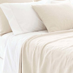 Om Coverlet - Sometimes only simplicity can complete a space; when that space is the bedroom, turn to the Om Coverlet.  While the surface is plain, look closer at the subtle grid of the smooth weave to see the expertise that went into this perfect balancing of linen and cotton fibers.  A well-chosen neutral makes the most of the easy-care coverlet's natural versatility and offers a canvas for styling.