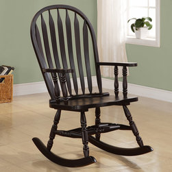 "Monarch - Cappuccino Arrow Windsor Back Rocking Chair - Whether you are a new mom looking to soothe a baby or just want place to sit and relax, this traditional styled wooden rocking chair will be a lovely addition to your home. This arrow Windsor back-�rocker has a curved top, soft wavy arms that frame the seat, turned spindle supports, and is finished in a rich cappuccino. Turned legs above the wood rocker base complete this charming look and add the perfect touch of warm tradition.; Assembly required; Weight: 27 lbs; Dimensions: 25""L x 33""W x 42""H"