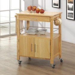 Sunset Trading - Sunset Trading Vancouver Kitchen Cart - Natural Multicolor - GRM-CRT-VAN-NN - Shop for Carts from Hayneedle.com! Make the most of your kitchen space by using the Sunset Trading Vancouver Kitchen Cart - Natural. Featuring a convenient mobile design this versatile kitchen cart offers easy access to your cooking items with a variety of storage options. It includes an open shelf for storage or display a cabinet for hidden storage a utility drawer and three hooks for cups or utensil storage. Made from eco-friendly Malaysian hardwood the Vancouver kitchen cart has a natural wood base and top and stainless steel hardware. Dimensions: 31L x 19W x 35H inches. About Sunset TradingThis product is designed and manufactured by Sunset Trading. Located in Londonderry New Hampshire Sunset Trading creates high quality furniture for bedrooms living and dining rooms. Their furniture features side roller drawer guides four corner English dovetails solids and veneers. Dining rooms feature epoxy resin constructed chairs with metal support brackets which make their chairs 100 times stronger than glued chairs. Rest assured you're making an excellent choice when you purchase a fine furniture item from Sunset Trading.