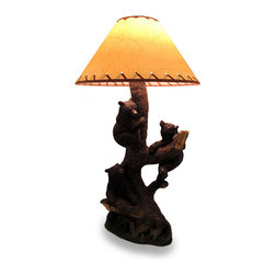 Zeckos - Three Playful Bear Cubs Climbing a Tree Decorative Lamp and Shade - It's always playtime in the animal kingdom as a trio of mischievous black bear cubs climb their way up an old tree trunk. Expertly cast in resin and with an intricately sculpted life-like finish, this lamp will add a bit of wilderness fun to any room whether in your home, or at the office. It uses 1 standard size Type A bulb (not included), and has an in-line thumbwheel switch on the 56 inch long cord to easily turn it on or off. Measuring 26 inches (66 cm) high, 9.25 inches (23 cm) long, 6.5 inches (17 cm) wide, and with a 7.5 inch high, 15 inch diameter leather look shade, this lamp will add a wildly charming accent sure to light up your life, and your home