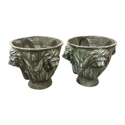 Pre-owned 1920s Cast Iron Urns - A Pair - A pair of decorative urns. The seller was told when purchased that they were from the 1920s and custom made for a home on 5th avenue in New York city. The urns have four lion heads on the outside of the urn. They are made of cast iron and weigh 65 pounds each. The urns are 13.5 inches in diameter and 13.5 inches tall.