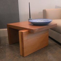 """Colorado Concrete Side Table - One piece concrete table supported on one size by thick, solid hickory wooden leg. Size: length 25.8"""" : width 21.8"""" : height 15"""" concrete thickness 2"""". Standard color: terracotta. Other colors available on request."""