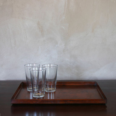 Pfeifer Studio Collection - This minimalist tray is formed from solid steel with an oxidized finished. It is treated with a clear lacquer for protection and features felts pads on the base.