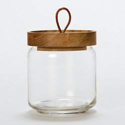 Teak Honey Jar - I've always found that honey jars have something romantic about them. Wouldn't transferring store-bought honey to your own heirloom jar give you the impression that you're in absolute control of your life? If I were ever to do this, I'd use this super cute jar. I just love that rope handle.