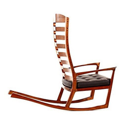 """Eco First Art 3 - FSC Euro Beech, Milk Paint,Ivory Faux Vinyl.""""I wanted it to feel as if you could sit down and drive off,"""" says the artis about his auto-inspired Kalifornia Rocker. The woodworker looked to cars from the 1950s and '60s to create the chair, whose subtly pointed slatted back mimics the prominent grills of classic cars such as the Buick LeSabre and Ford Falcon."""
