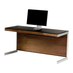 BDI - Sequel Desk by BDI - The piece from which all Sequel office configurations are founded. The BDI Sequel Desk is a versatile work surface that combines a sleek steel frame, magnetically attachable wood panels and a black glass top. Use both the front and back panels for a finished look in the middle of a room or, when set against the wall, leave the back panel off for direct access to wall outlets. Doesn't your TV deserve the best? Under the ongoing direction of founder Bill Becker, BDI home theater and office furniture have been making audio, visual and computer technology--not to mention the modern settings around it--look good since 1984. With clean lines and precise engineering, BDI furniture is both highly contemporary and functional, as much a pleasure to look at as it is to use.