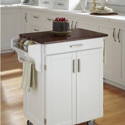 """Home Styles - Kitchen Cart - Home Styles Cuisine Kitchen Cart with a .75"""" finished top features solid wood construction. Features: -Two cabinet doors open to storage with adjustable shelves inside.-Handy spice rack, towel bar.-Heavy duty locking rubber casters for easy mobility and safety.-Product Type: Kitchen Cart.-Collection: Cuisine Cart.-Counter Finish: Cherry wood.-Hardware Finish: Brushed Steel.-Distressed: No.-Powder Coated Finish: No.-Gloss Finish: No.-Base Material: Wood.-Counter Material: Cherry wood.-Hardware Material: Brushed steel.-Solid Wood Construction: Yes.-Number of Items Included: 1.-Water Resistant or Waterproof Cushions: No.-Stain Resistant: No.-Warp Resistant: No.-Exterior Shelves: No.-Drawers Included: Yes -Number of Drawers: 1.-Push Through Drawer: No..-Cabinets Included: Yes -Number of Cabinets : 1.-Double Sided Cabinet: No.-Adjustable Interior Shelves: Yes.-Number of Doors: 2.-Locking Doors: No.-Door Handle Design: Linear pulls..-Towel Rack: Yes -Removable Towel Rack: No..-Pot Rack: No.-Spice Rack: Yes .-Cutting Board: No.-Drop Leaf: No.-Drain Groove: No.-Trash Bin Compartment: No.-Stools Included: No.-Casters: Yes -Locking Casters: Yes.-Removable Casters: No..-Wine Rack: No.-Stemware Rack: No.-Cart Handles: No.-Finished Back: Yes.-Commercial Use: No.-Recycled Content: No.-Eco-Friendly: No.-Product Care: Clean with a damp cloth.Specifications: -ISTA 3A Certified: Yes.Dimensions: -Overall Height - Top to Bottom: 35.5"""".-Overall Width - Side to Side: 32.5"""".-Overall Depth - Front to Back: 18.75"""".-Width Without Side Attachments: 27.25"""".-Height Without Casters: 31.75"""".-Countertop Thickness: 0.75"""".-Countertop Width - Side to Side: 27.25"""".-Countertop Depth - Front to Back: 18.75"""".-Shelving: -Shelf Width - Side to Side: 23.25"""".-Shelf Depth - Front to Back: 14.75""""..-Leaf: No.-Drawer: -Drawer Interior Height - Top to Bottom: 1.5"""".-Drawer Interior Width - Side to Side: 20.25"""".-Drawer Interior Depth - Front to Back: 13.25""""..-Cabinet: -Cabinet Interior """
