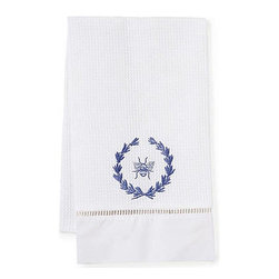 Jacaranda Living - Waffle-Weave Guest Towel, Blue Bee Wreath - A beautiful, blue bee wreath, embroidered like a crest against a white background, is the focal point of this compelling towel. This simple yet memorable waffle weave guest towel has been trimmed with ladder lace and cotton percale, and was made by Zulu women in South Africa, in a socially responsible environment. This is a towel you can feel good about hanging in your bathroom.