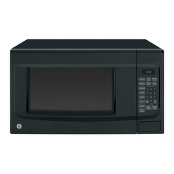 GE - GE Black 1.4-cubic foot Countertop Microwave Oven - This black countertop microwave oven from GE makes food preparation easier than ever before. Featuring sensor cooking controls and weight and time defrost,the 1.4 cubic foot capacity appliance easily accommodates everything from snacks to main meals.
