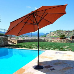 "Galtech 11-ft. Maximum Shade Deluxe Aluminum Auto Tilt Patio Umbrella - Add the perfect accessory to your poolside or your deck with the Galtech 11-ft. Aluminum Maximum Shade Deluxe Auto Tilt. This extra large octagonal shade is perfect for use with a 60-inch and up round or square dining table. In fact, due to its large 11-foot size, it's recommended that you only use this umbrella through a table, and with a 75-pound stand. It is not recommended for free-standing use. Choose from several fashionable finishes for your aluminum pole and from a whole rainbow of colors for your shade. This shade is made of top-of-the-line Sunbrella fabric; the absolute best you can get for outdoor use. This umbrella opens via a crank lift, and features an auto tilting mechanism to maximize your time in the shade. The resin hub and finial are very durable and less likely to break if the umbrella should tip. Note: Standard umbrella has overall height of 96 inches and is designed to fit patio dining tables 29-30 inches in height. Bar height umbrella has overall height of 102 inches and is designed to fit bar patio tables measuring 39-42 inches in height. What distinguishes Galtech Market, Patio, and Offset Umbrellas from the rest?Galtech International continuously strives to produce the most innovative market and patio umbrellas. Galtech's goal is to integrate the finest components available, from stainless steel cable to solid resin hubs, to create the most beautiful, durable, and functional patio umbrellas imaginable. They manufacture an umbrella in every size, shape, and functionality available.Market umbrellas and offset umbrellas range in size from 7.5 to 11 feet and are available in wood or aluminum poles. Most aluminum umbrellas feature threaded coupling, solid resin hubs and finials, dynamic auto-tilt, and stainless steel cable. Some aluminum umbrellas feature auto-locking metal housing that secures the umbrella in its tilted position. Wood market umbrellas feature threaded coupling, premium multi-layer finishes, and a brass base sleeve to protect the pole base from moisture. Some wood umbrellas also feature decorative brass trim on the ribs and rotational tilt to expand afternoon shade. About SunbrellaSunbrella has been the leader in performance fabrics for over 45 years. Impeccable quality, sophisticated styling and best-in-class warranties prove the new generation of Sunbrella offers more possibilities than ever. Sunbrella fabrics are breathable and water-repellant. If kept dry, they will not support the growth of mildew as natural fibers will. Beautiful and durable, Sunbrella is a name you can trust in your outdoor furniture.Cleaning and Caring for SunbrellaRegular maintenance is the best way to keep your Sunbrella fabrics looking good and delay deep, vigorous cleaning. Brush off dirt before it becomes embedded in the fabrics, and wipe up spills as soon as they occur. For light cleaning, use a mild soap and water solution and a sponge, allowing your cleaning solution to soak into the fabric. Rinse thoroughly to remove all soap residue and allow fabric to air dry.Sunbrella fabrics have been tested to provide up to 98% UV protection, depending on depth of color. Whites and lighter colored fabrics provide less protection than darker fabrics. This protective factor is inherent to the product and will not diminish through use or exposure to the sun. Sunbrella furniture and umbrella fabrics have been awarded the ""Seal of Recommendation"" by the Skin Cancer Foundation, an international organization dedicated to the prevention of skin cancer. Beautiful and protective fabric is the hallmark of Sunbrella.We're now proud to offer Sunbrella A and B fabric choices - our A line includes beautiful stripes and textures, including a linen-like feel and look. Nothing beats Sunbrella when it comes to outdoor quality and style."