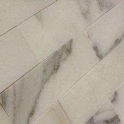 Calacatta Gold Marble Tiles & Mosaics ITALIAN MARBLE - Calacatta Gold Honed Marble bathroom floor and wall .. accent wall .. design and decor .arabescato.