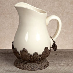 GG Collection Ceramic Pitcher with Metal Base - Cream - With its organically inspired design reminiscent of Art Nouveau, this Gerson GG Collection Gracious Goods Ceramic Pitcher with Metal Base – Cream brings Old-World artistry to contemporary kitchens and dining rooms. Crafted from durable, cream-colored ceramic with a foliate-styled base of brown cast aluminum, this elegant pitcher has a graceful form and ample handle for stylish service in hand or at rest.