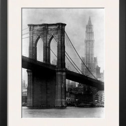 Artcom - Brooklyn Bridge and Woolworth Building, 1921 by Irving Underhill Artwork - Brooklyn Bridge and Woolworth Building, 1921 by Irving Underhill is a Framed Art Print set with a SOHO Thin wood frame and a Polar White mat.