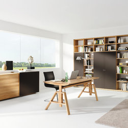 Atelier modern oak desk - The luxurious Atelier desk is height adjustable in 5 increments from 68cm to 81cm high. It includes a cable outlet and integrated cable trunking. Available in alder, beech, cherry, oak and walnut.