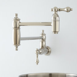 Augusta Retractable Wall-Mount Pot Filler - This retractable wall mount pot filler extends to easily reach pots and pans on your range burners. With beautifully rounded joints and metal lever handles, this faucet is perfect for use in commercial and home kitchens alike. Solid brass construction.