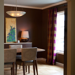 Bold colored drapery in a deep brown colored dining room - Silk drapery in warm jeweled tones of fuchia and dark beige compliment to deep brown colored walls in this period San Francisco dining room.