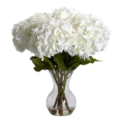 "Nearly Natural - Large Hydrangea w/Vase Silk Flower Arrangement - ""Substantially delicate"" is the perfect phrase to describe this beautiful faux Hydrangea and vase set. The substantial part comes from stems of this flower - tall, green, and thick, they let you know that this is indeed a plant to be reckoned with. The delicate part comes from the billowy blooms - almost like a fluff of cotton in look. Combined in an attractive vase w/ liquid illusion, this beautiful Hydrangea will stay ""forever fresh"", and will brighten your decor for years to come."