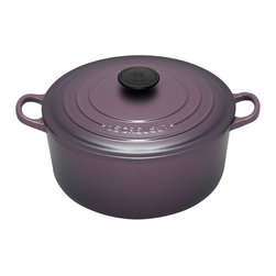 Le Creuset - Le Creuset Cassis Signature Round French Oven Multicolor - LS2501-2272 - Shop for French Ovens from Hayneedle.com! The color of the Le Creuset Cassis Signature Round French Oven comes from black current liquor. Stunningly gorgeous yet practical too this versatile French oven adds panache and perfect pot stickers to your kitchen. It features the signature casis purple enamel exterior and an enameled interior that both offer chip- and crack-resistant virtually nonstick finishes that stays beautiful for years. This round French oven features ergonomic handles unmatched heat conduction and dishwasher-safe properties that will make it your favorite. It includes a tight-fitting lid that keeps moisture in a lifetime warranty to back it up and stunning style. Available in your choice of size. Savor the sweetness of home cooking. About Le Creuset of America Inc.From its cast iron cookware to its teakettles and mugs Le Creuset is a global standard of inimitable color and quality. Founded in 1925 in the northern French town of Fresnoy-Le-Grand Le Creuset still produces enameled cast iron in its original foundry. Its signature color Flame was modeled after the intense orange hue of molten cast iron within a cauldron (or Creuset in French) and has been a Le Creuset bestseller from the company's first year to the present day. Though best known for its vibrantly colored cookware and original inventions such as the Dutch oven Le Creuset has also forged a name as a creator of stoneware mugs and enamel-coated stainless steel teakettles. The style and performance of Le Creuset's Cafe Collection and tea accessories are rooted in classic French cookware: bold colors cylindrical loop handles unmatched thermal resistance and heat distribution and of course the iconic Le Creuset three-ring accent. Through its consistent qualities of authenticity originality and innovation Le Creuset maintains a connection to both heritage and modernity.