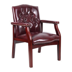BOSS Chair - Mahogany Finish Guest Chair with Burgundy Uph - Smooth oxblood hued upholstery gives this guest chair a regal appearance. The button tufted back and padded arms with brass finished nail head trim make this piece welcome in any traditional den or office. The dark mahogany stained frame compliments the rich color. Classic traditional button tufted styling. Elegant traditional mahogany finish on all wood components. Hand applied brass nails Oxblood vinyl (BY)or black (BK) Caressoft vinyl. Matching guest chair for model (B905). Cushion color: Burgundy. Base/wood: Mahogany. Seat size: 20 in. W x 19 in. D. Seat height: 18 in. H. Arm height: 25 in. H. Overall dimension: 24.5 in. W x 27 in. D x 35.5 in. H. Weight capacity: 250 lbs