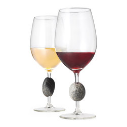 Sea Stones - Stone Wine Glasses - Set of 2 - Made from recycled glass and the same smooth New England stones that grace all of our work, our Stone Wine Glasses are an elegant and versatile take on the traditional wineglass. Perfectly sized to accommodate reds, whites, or water, the stone that's part of each glass enhances your favorite drink while making it a pleasure to hold and behold. The graceful glasses were inspired by cairns, the man-made rock markers arranged throughout New England's mountains to help hikers find their way. The smooth stone encourages the sipper to hold the glass by its stem for a pure taste unchanged by the heat of their hand. Since glasses are made from handpicked stones, no two are the same, so there's no more confusion over whose glass is whose. Sold as a set of 2. Stone Wine Glasses are the perfect companion for our Stone Bottle Stoppers. Hand wash gently with soap and water.