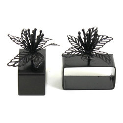 "MarktSq - Wrought Iron Napkin Ring (Set of 4) - This beautiful napkin ring is made of wrought iron and has a black nickel finish. Sold as a set of 4. The height of the napkin ring is 2.25"" and inner width is 2""."