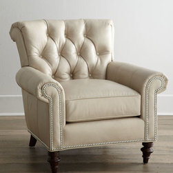 "Horchow - Starlite Leather Chair - Classic rolled-arm chair takes on new allure with turned front legs and a button-tufted back. Neutral nailhead trim outlining the arm panels and base add a distinctive touch. Leather upholstery. 36.5""W x 38.5""D x 36.5""T. Imported. Boxed weight, appr..."